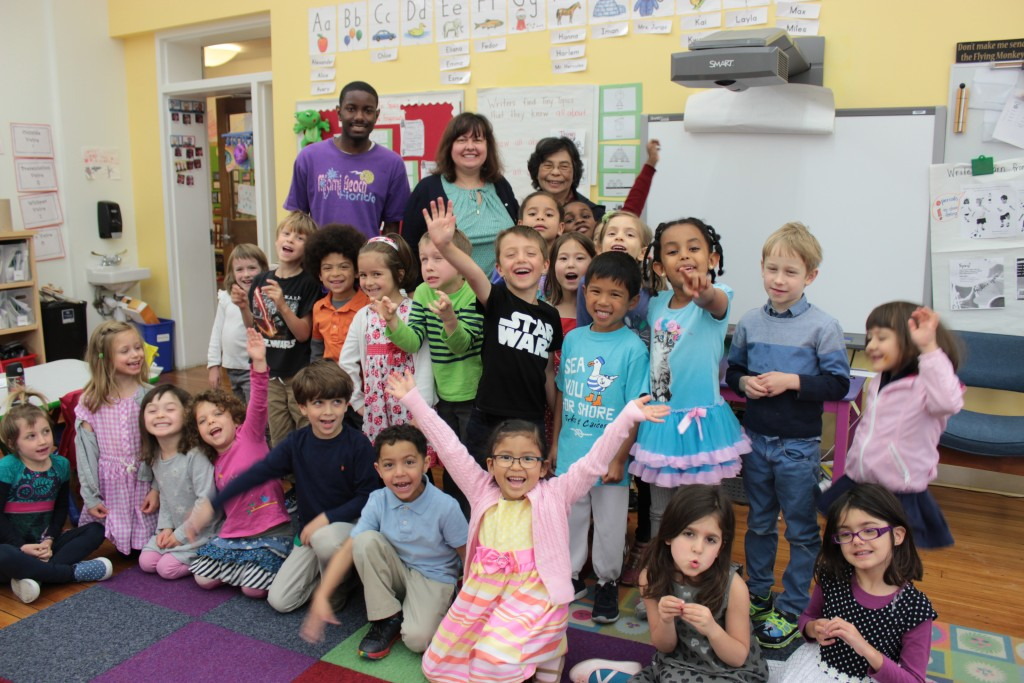 RESET Volunteer Maria Turner (back row, center) with Kindergarten students and teachers at Ross elementary School